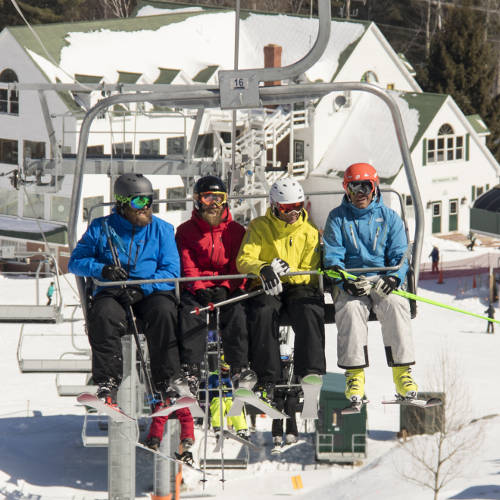 Patrons riding the chair lift.