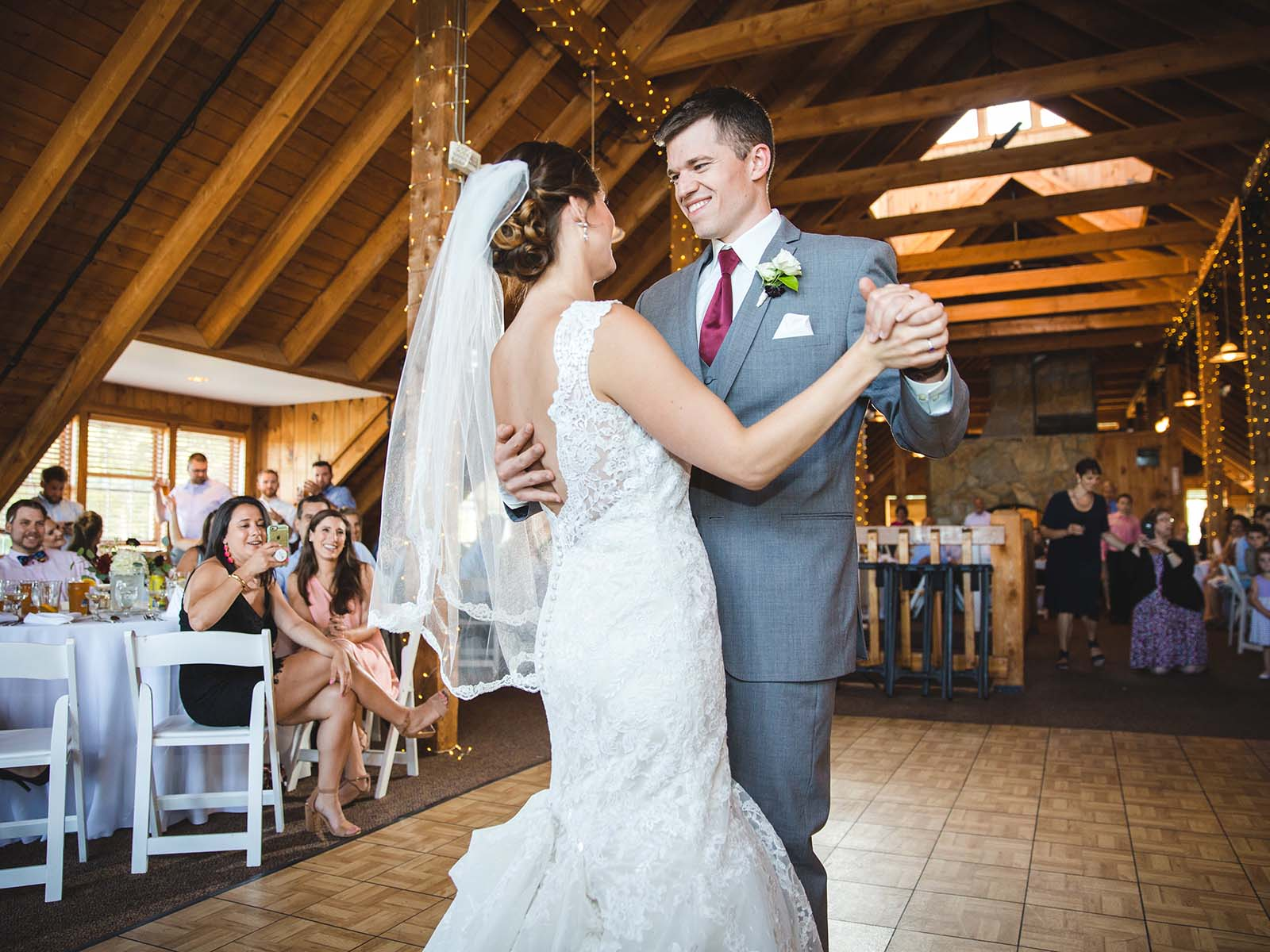 A bride and groom celebrating with their first dance.
