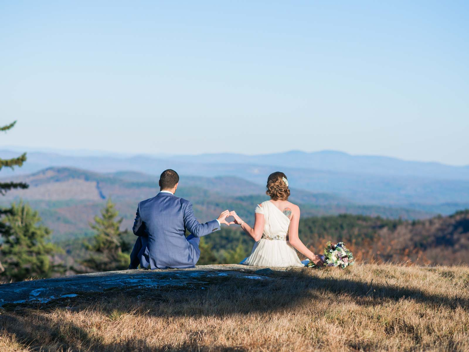 A bride and groom at the summit of Ragged Peak.