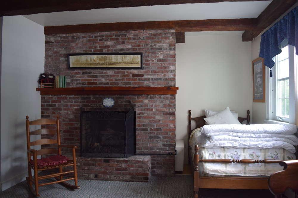 Keep warm by the fireplace in the Eagle Pond room